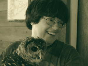 Patti Reynolds with Moonshine the Barred Owl